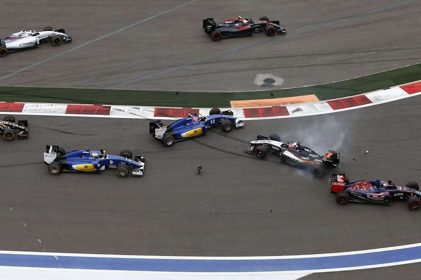 Toro Rosso driver Max Verstappen (right) crashes into Force India driver Sergio Perez (second right) at the start of the 2015 Formula One Grand Prix of Russia at the Sochi Autodrom circuit, in Sochi, Russia, on Oct 11, 2015.