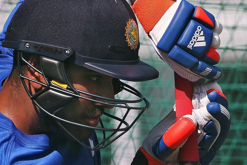 India's Rohit Sharma bats in the nets during a practice session ahead of their first one-day international cricket match against South Africa in Kanpur, India, Oct 10, 2015.