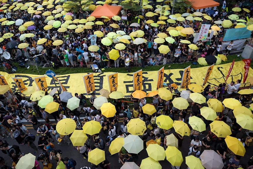 Protester hold yellow umbrellas outside the Legislative Council during a march in Hong Kong, China, on Sept 28, 2015.