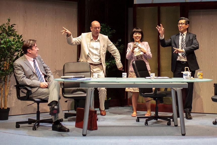 A scene from Pangdemonium's production of the play Chinglish. (From left) actors Daniel Jenkins, Matt Grey, Audrey Luo and Adrian Pang.