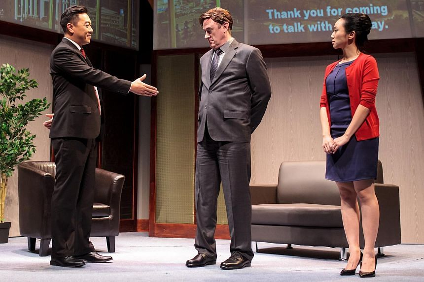 A scene from Pangdemonium's production of the play Chinglish. (From left) actors Guo Liang, Daniel Jenkins and Oon Shu An.