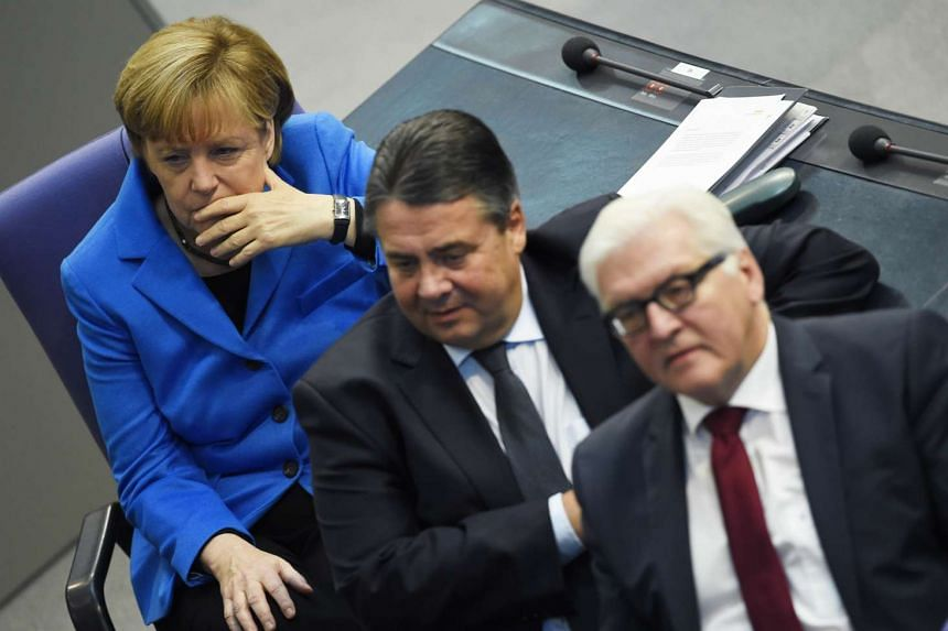 Picture taken on November 7, 2014 shows (left to right) German Chancellor Angela Merkel, German Vice Chancellor, Economy and Energy Minister Sigmar Gabriel and German Foreign Minister Frank-Walter Steinmeier at the German Lower House of Parliament (B