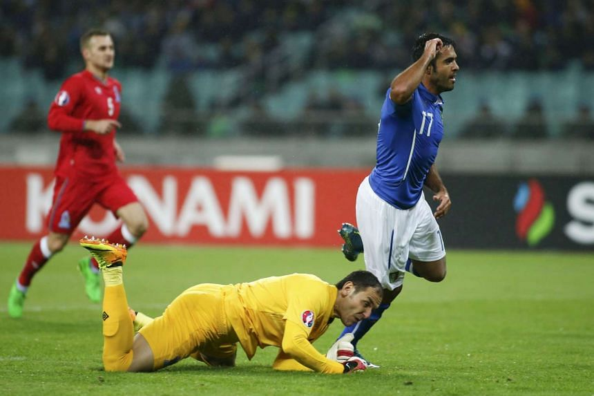 Italy's Eder (right) celebrates his goal as Azerbaijan's goalkeeper Kamran Agayev reacts during their Euro 2016 group H qualifying soccer match at the Olympic Stadium in Baku, Azerbaijan, on Oct 10, 2015.