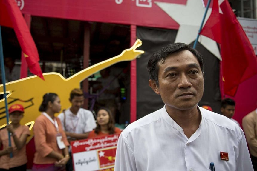 National League for Democracy (NLD) party candidate Win Min walks during an NLD campaign in Yangon on Oct 6, 2015. A sparsely populated cluster of Indian Ocean islands has become the unlikely focus of allegations that Myanmar's government is spiking