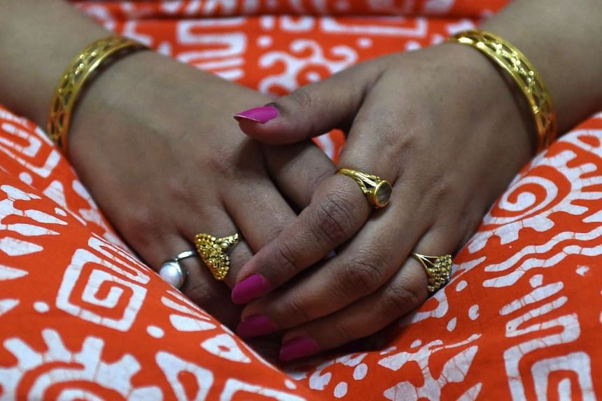 In this photograph taken on Sept 14, 2015, Indian woman Geetanjali Agarwal displays her gold jewellery during an interview with AFP at her residence in New Delhi. Industry experts say India has around 20,000 tonnes of the precious metal lying idle in