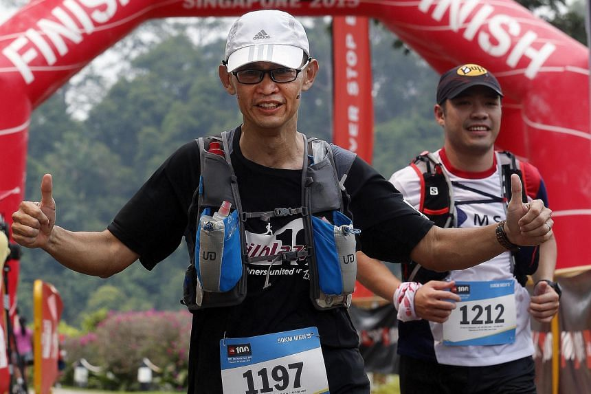 Mr Harry Teo, 47, completed yesterday's race with 32 runners from the group Trailblazer100, formed by running enthusiasts from HCA Hospice Care, which looked after his daughter Kristie in her final days.