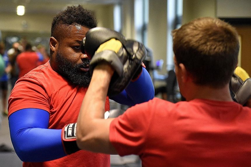 French centre Mathieu Bastareaud (left) during an indoor training session in Wales. France and Ireland want to win their clash to avoid the Kiwis.
