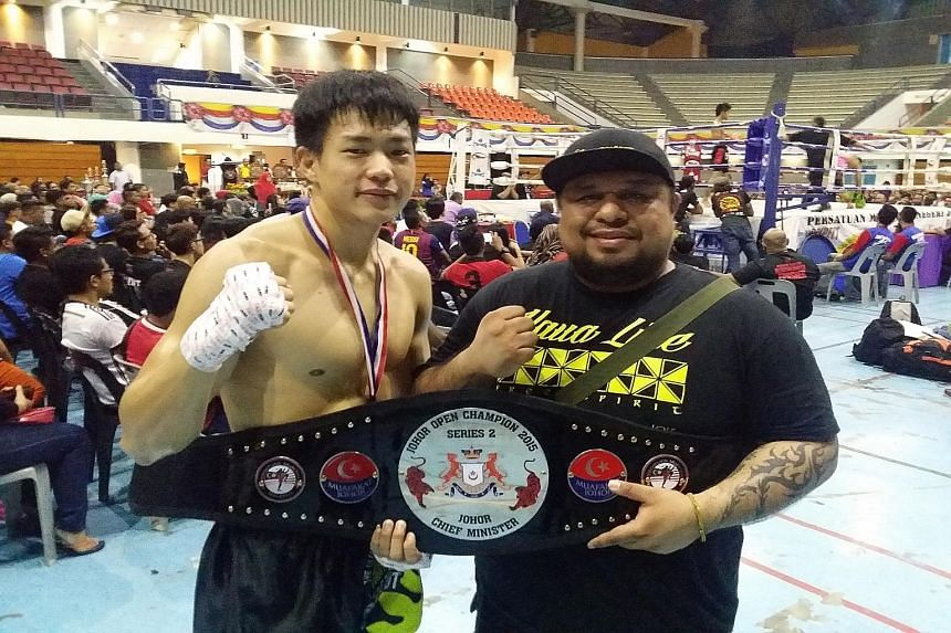 Terrence Teo and his coach Arvind Lalwani after winning his first professional muay thai championship. He says his good technique makes up for a lack of experience.