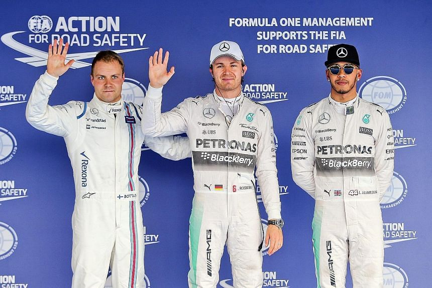 Mercedes F1 driver Nico Rosberg (centre) and third-fastest qualifier Valtteri Bottas (left) of Williams looking delighted while world champion Lewis Hamilton is subdued after being beaten to pole position in Sochi.