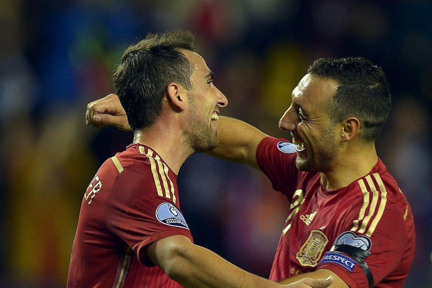 Paco Alcacer (far left) and Santi Cazorla each netted twice during Spain's 4-0 thrashing of Luxembourg in Logrono for the defending champions to qualify for Euro 2016.