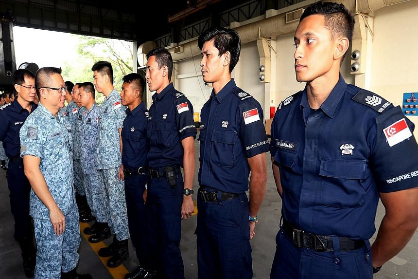(From left) SCDF Commissioner Eric Yap and Chief of Air Force, Major-General Hoo Cher Mou, sending off the SAF and SCDF personnel at Sembawang Airbase. The group was set to take off on Friday but was delayed by poor visibility in Palembang. Singapore