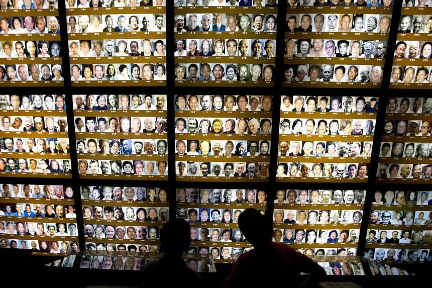 Visitors looking at a wall of survivors' images at the Nanjing Massacre Memorial Hall in Nanjing. The massacre, often referred to as the Rape of Nanjing, is an exceptionally sensitive issue in relations between Japan and China, with Beijing charging