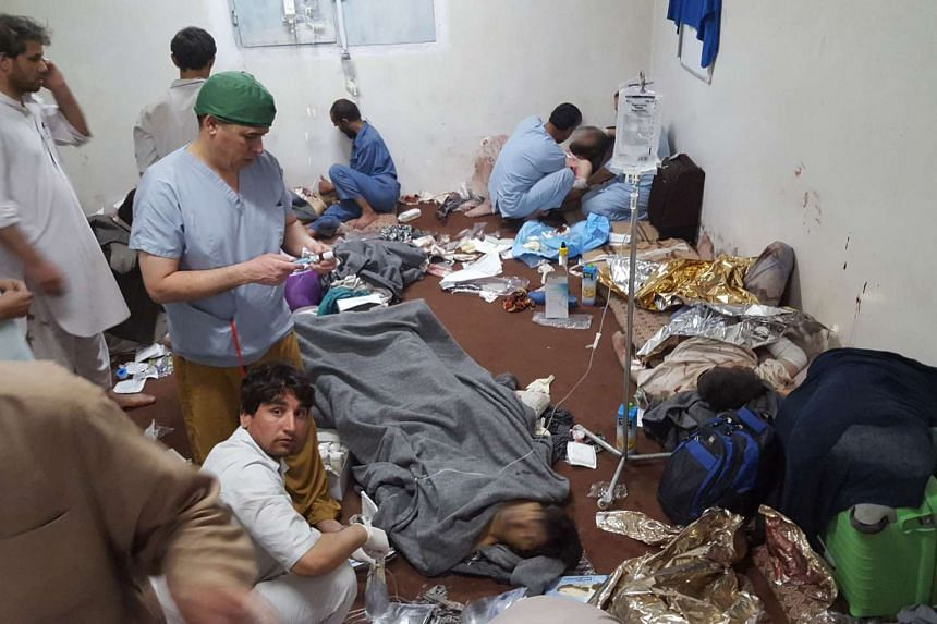 Medical personnel treat wounded colleagues and patients after the airstrike.