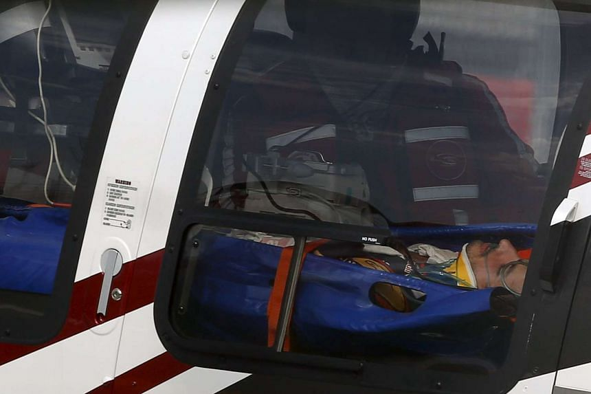 Carlos Sainz lies in a medical helicopter after he crashed during the third practice session of the Russian F1 Grand Prix.