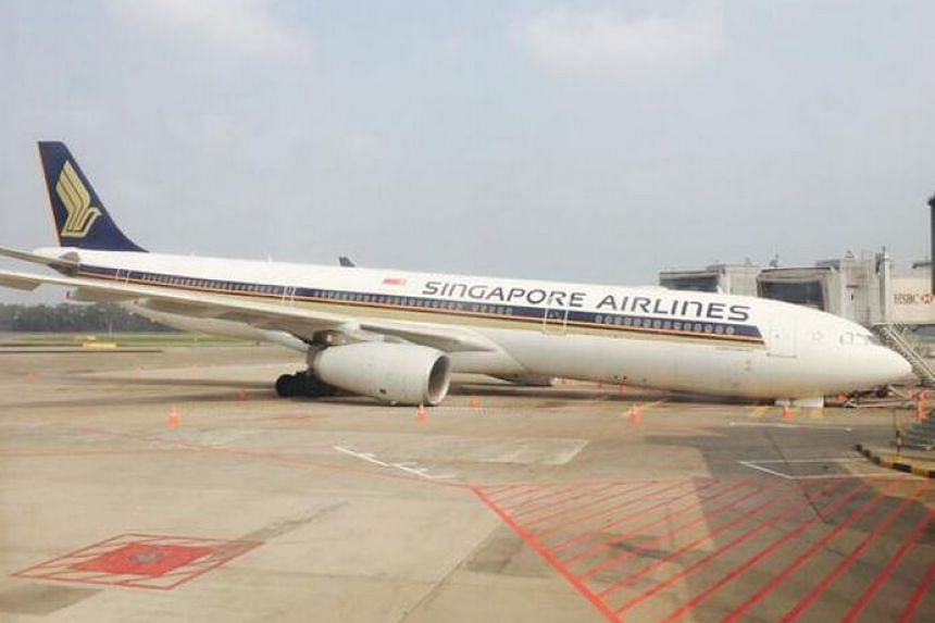 The Singapore Airlines plane lying on its front at Changi Airport, after its nose gear collapsed on Sunday morning.