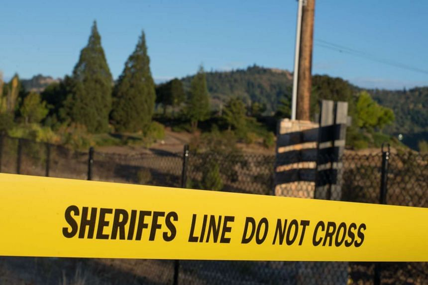 Police tape is seen near a blocked road in a state in the US.