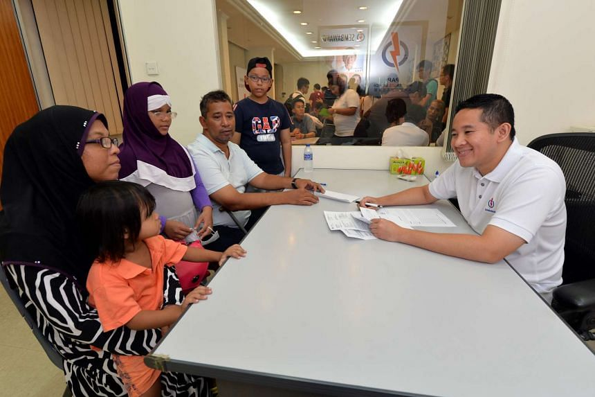 Sembawang GRC MP Amrin Amin at his first Meet-the-People Session last month. He is promoting social mobility by encouraging needy schoolchildren in his constituency to work hard for their exams.