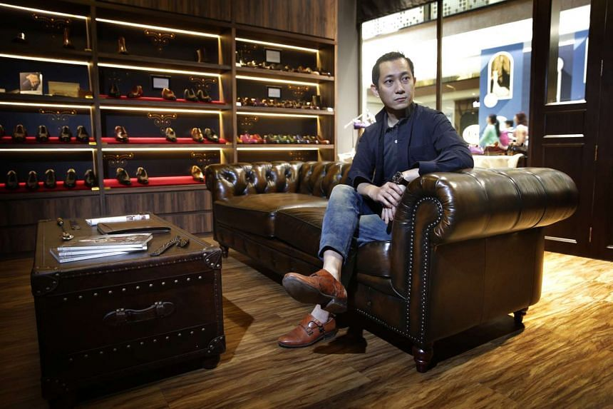 """Mr Edwin Neo's shop ed et al opened in MilleniaWalk about two years ago. It is decorated with a seasoned Chesterfield sofa and leather coffee table to look like a """"gentleman's living room""""."""