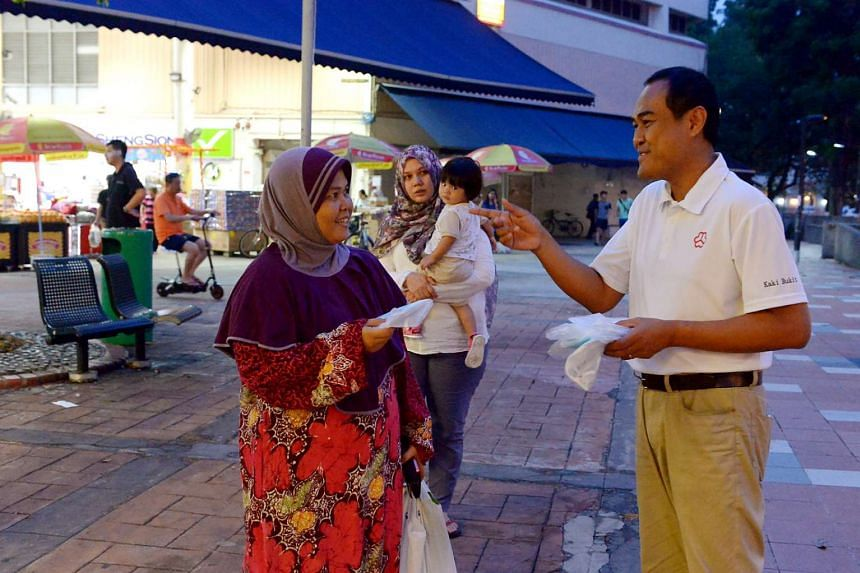 Mr Shamsul Kamar, a PAP candidate for Aljunied GRC, distributing N95 masks in Bedok North Street 3 on Sept 15. Since the Sept 11 polls, the five-member team and their activists have been on the ground almost every day, and have distributed close to 1