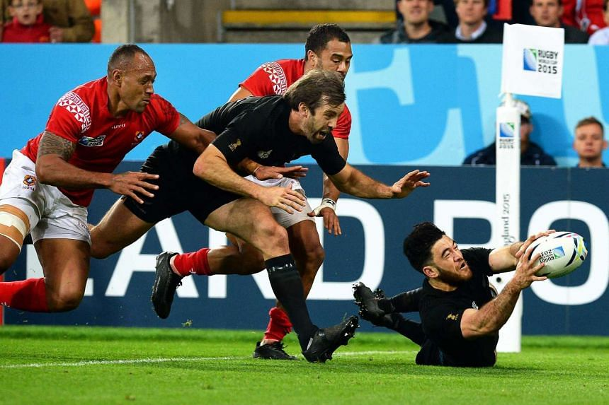 Nehe Milner-Skudder (right) makes use of his pace to reach a Beauden Barrett grubber kick to score a try against Tonga.