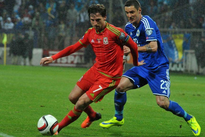 Wales' Joe Allen (left) vies with Bosnia and Herzegovina's Sejad Salihovic.