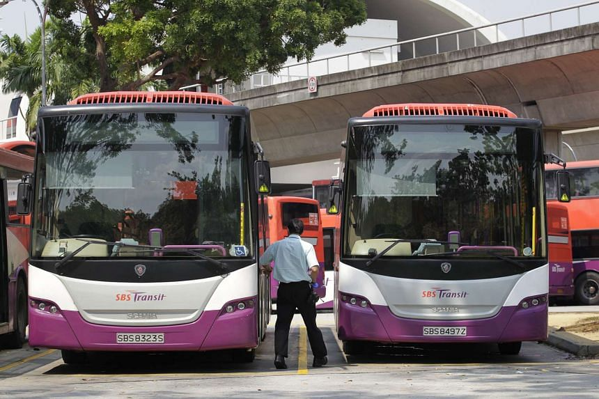 SBS buses and drivers at Pasir Ris bus interchange.