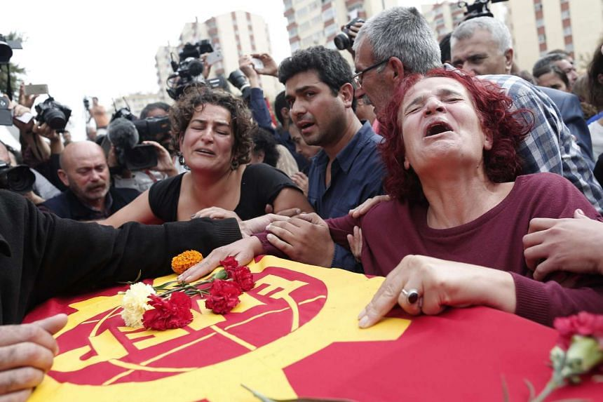 Relatives mourn a victim of the twin blasts in Ankara, which killed at least 97 people at a pro-Kurdish peace rally.