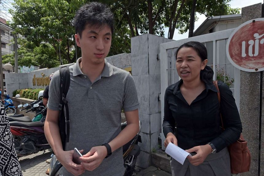 Hong Kong photojournalist Anthony Kwan Hok-chun (left) was held on Aug 23 after trying to depart Bangkok's Suvarnabhumi airport with a flak jacket and helmet in his hand luggage.