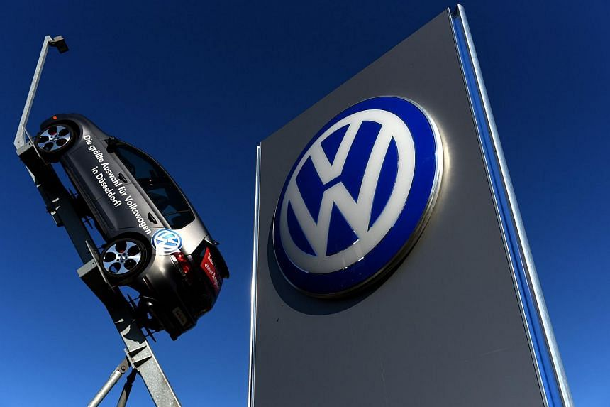 A model and logo of German car maker Volkswagen (VW) are seen at the entrance to a VW branch in Duesseldorf, western Germany.