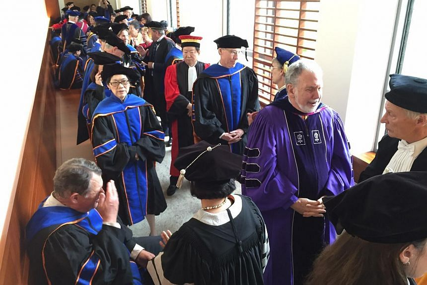 Yale-NUS College leadership and faculty line up for their ceremonial procession into the auditorium before the inauguration on Oct 12, 2015.