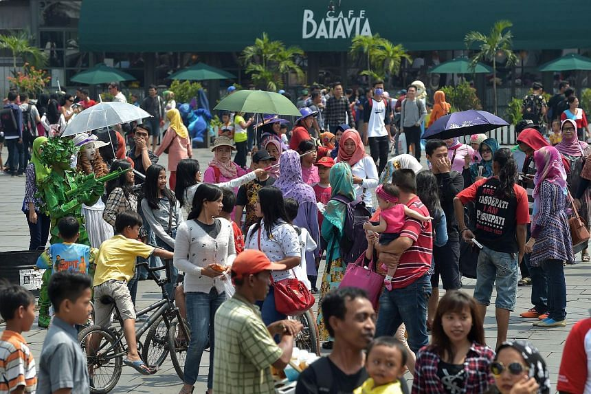 Indonesian tourists visit the square outside the Jakarta History Museum in the popular Kota Tua tourism site in Jakarta on Aug 23, 2015.