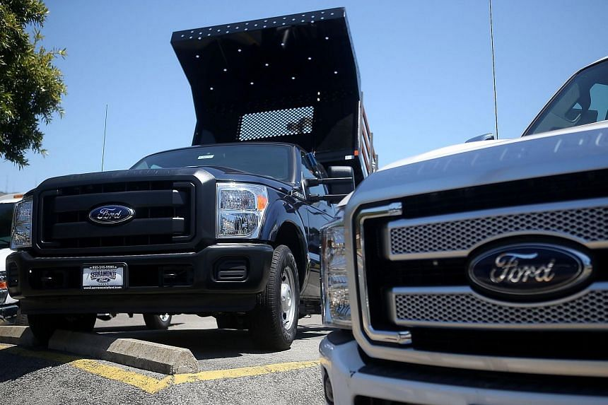 Brand new Ford trucks are displayed on the sales lot at Serramonte Ford on July 28, 2015 in Colma, California.