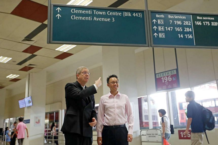 Sir David Clementi (left) with Jurong GRC MP Tan Wu Meng at Clementi Town Centre.