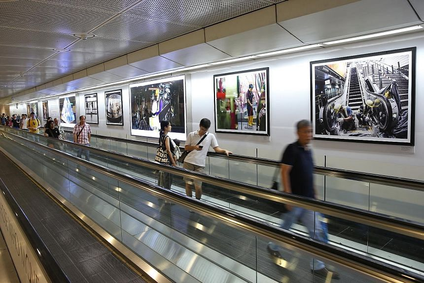 Commuters at Dhoby Ghaut MRT station can get a behind-the-scenes glimpse into the building of Singapore's new train lines through a photo exhibition put together by the Land Transport Authority and Canon Singapore. The exhibition, Those Who Move Us,
