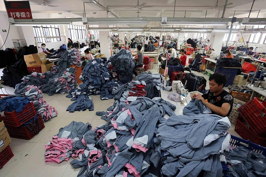 Chinese workers making jeans at a clothing factory in Shishi, east China's Fujian province. China's exports, imports and trade balance data for September, to be released tomorrow, will likely give investors clues on the strength of the Chinese econom