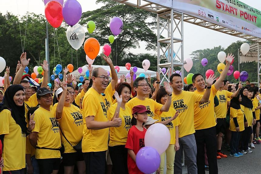 Close to 7,000 participants took part in the Chua Chu Kang B.I.G. Farm Walk and Run yesterday. The event in Brickland Road, which was organised by Chua Chu Kang GRC and Hong Kah North SMC, was attended by their MPs. They are (from left in row behind