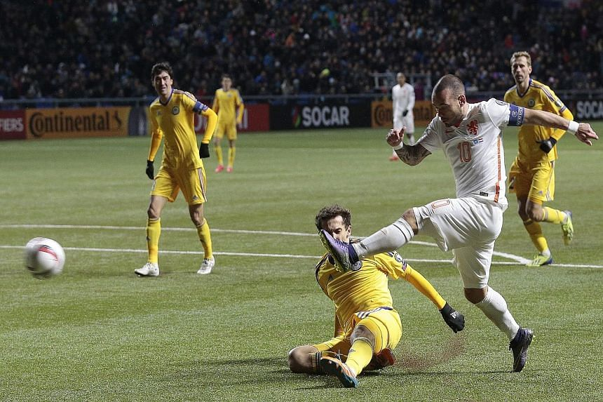 Wesley Sneijder (in white) of the Netherlands scoring his side's second goal in the 2-1 victory against Kazakhstan in the Euro 2016 Group A qualifier in Astana, Kazakhstan on Saturday. In order to qualify, the Dutch must beat the Czech Republic tomor