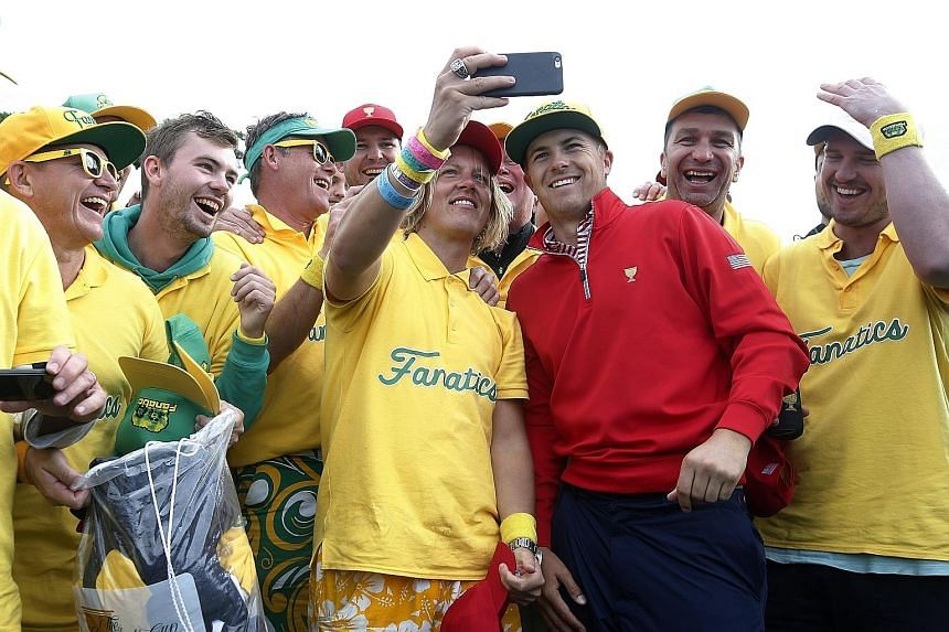 World No. 1 Jordan Spieth obliges fans after the United States edged out the Internationals to win the Presidents Cup for the ninth time.