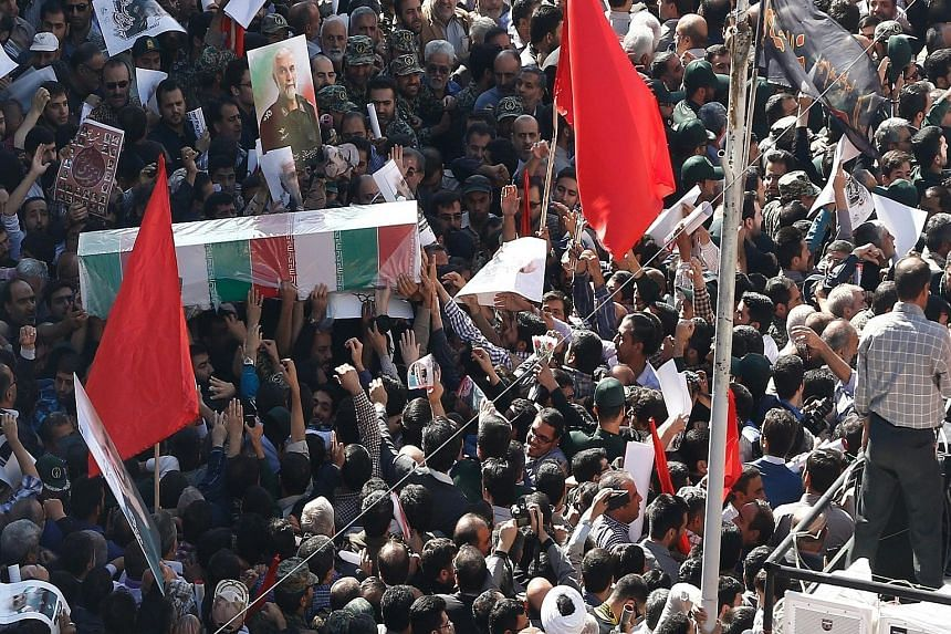 Iranian mourners carrying the coffin of Iranian Revolutionary Guards commander Hossein Hamadani during his funeral in Teheran yesterday. Reports said that General Hossein, an adviser to the Syrian government, was killed by ISIS in an area on the outs