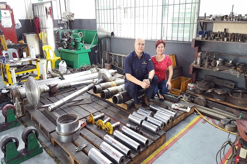Director of Toyo Chromium Engineering Emily Tan and her brother, Mr Larry Tan, the company's managing director. Besides being affected by falling oil prices, the firm is facing a labour crunch.