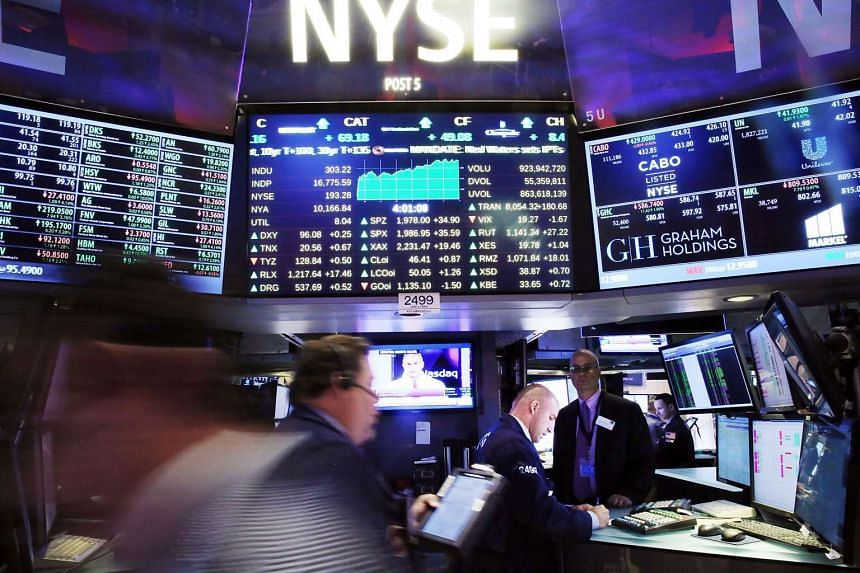 A file picture of traders at work on the floor of the New York Stock Exchange (NYSE). PHOTO: AFP