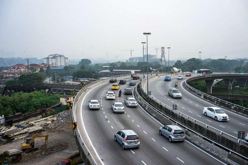 Motorists drive along a highway in Kuala Lumpur, Malaysia, on Tuesday, Sept 29, 2015.