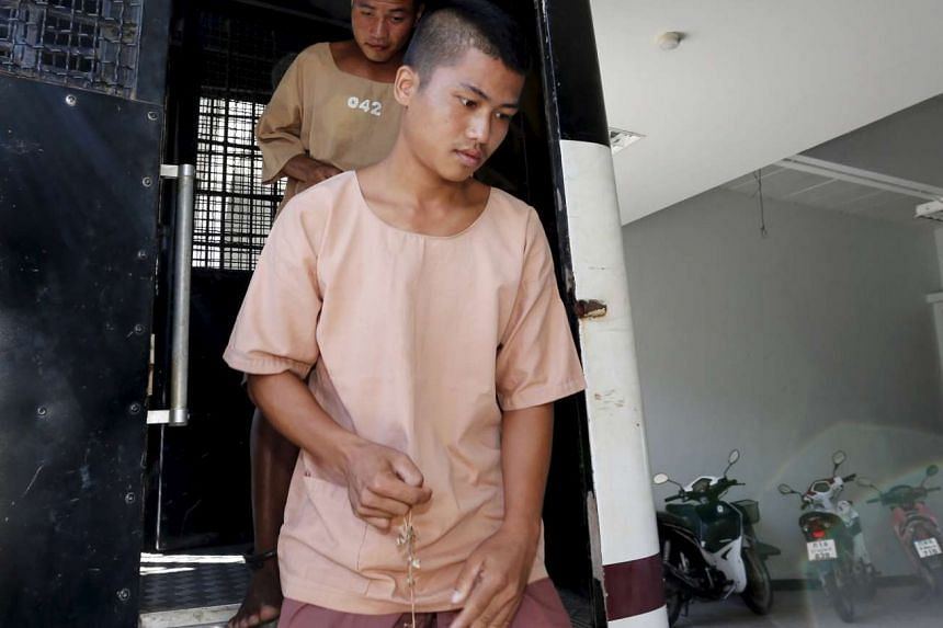 Myanmar migrant workers Zaw Lin (right) and Win Zaw Htun arrive at the Koh Samui Provincial Court, in Koh Samui, Thailand, on July 22, 2015.