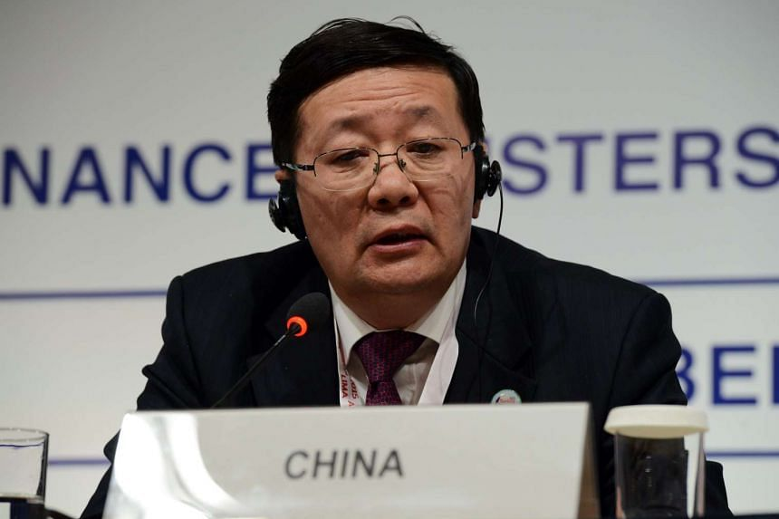 China's Finance Minister Lou Jiwei at a G-20 governors' press conference at the IMF/World Bank annual meetings in Lima, Peru, on Oct 9, 2015.
