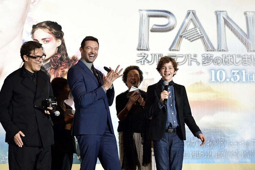 Pan cast members, Australian actors Hugh Jackman (centre) and Levi Miller (right), on stage with British director Joe Wright (left) at the Japanese premiere of the movie in Tokyo on Oct 1, 2015.