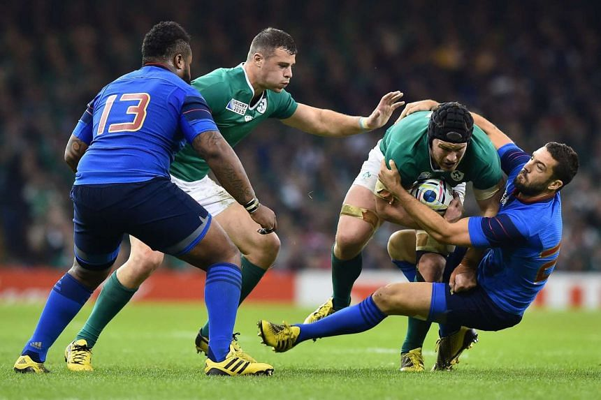 France's fly half Remi Tales (right) tackles Ireland's flanker Sean O'Brien during a Pool D match of the 2015 Rugby World Cup between France and Ireland at the Millennium Stadium in Cardiff, south Wales, on Sunday.