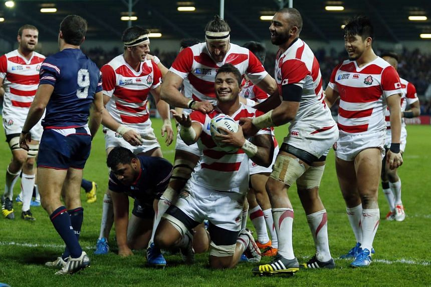 Japan's Amanaki Mafi celebrates scoring a try in a victory over the US in World Cup Rugby.