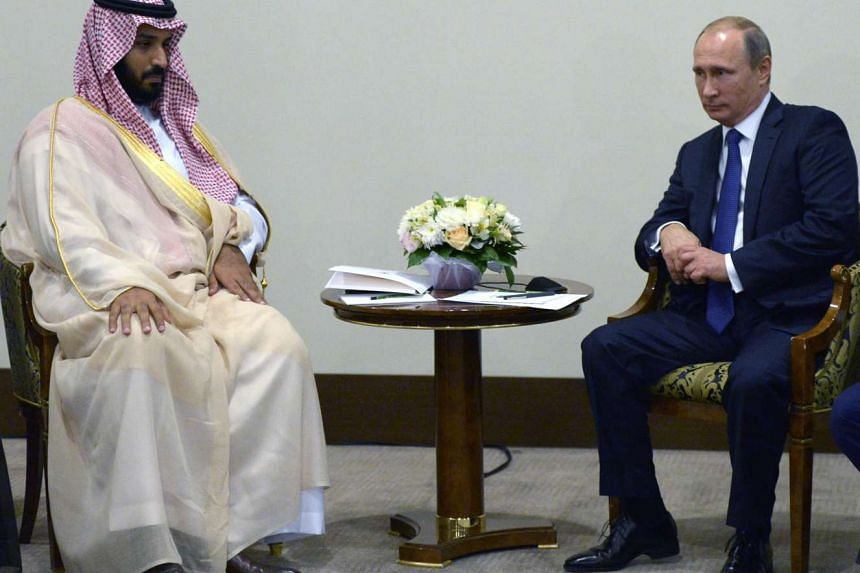 Russian President Vladimir Putin (right) meets with Deputy Crown Prince, Second Deputy Prime Minister and Defense Minister of Saudi Arabia Mohammad bin Salman Al Saud on Sunday in Sochi.