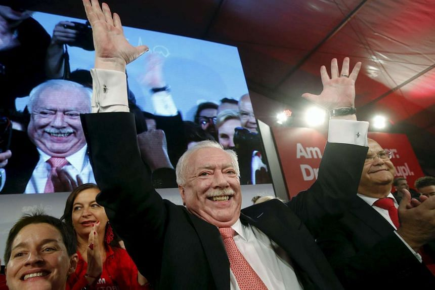 Mayor and province governor of Vienna, Michael Haeupl of the Social Democratic Party (SPOe) celebrates in front of supporters after winning regional elections in Vienna, Austria on Sunday.