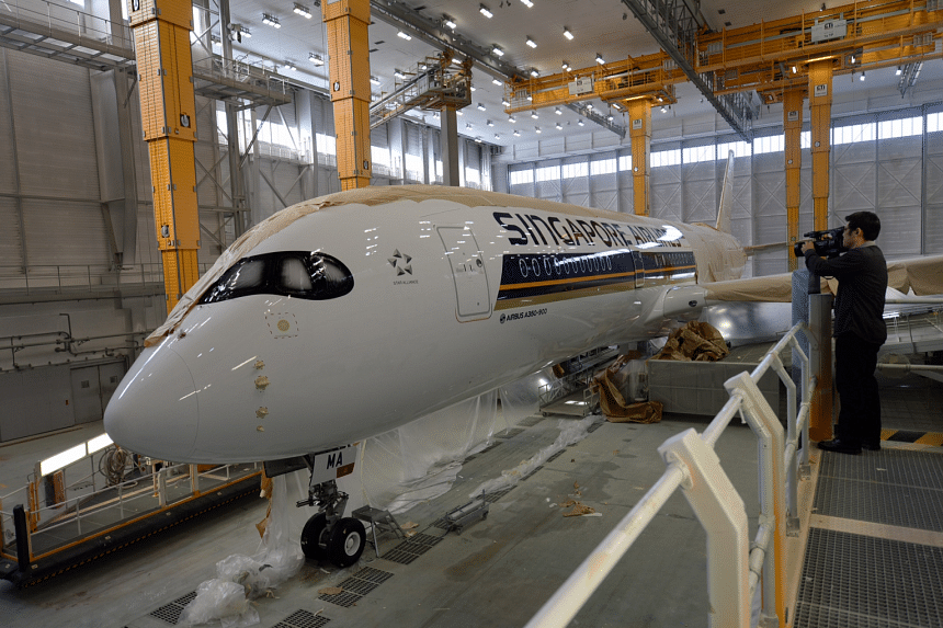 SIA A350 XWB in the paint shop at the Airbus HQ in Toulouse, France on 12 Oct, 2015.